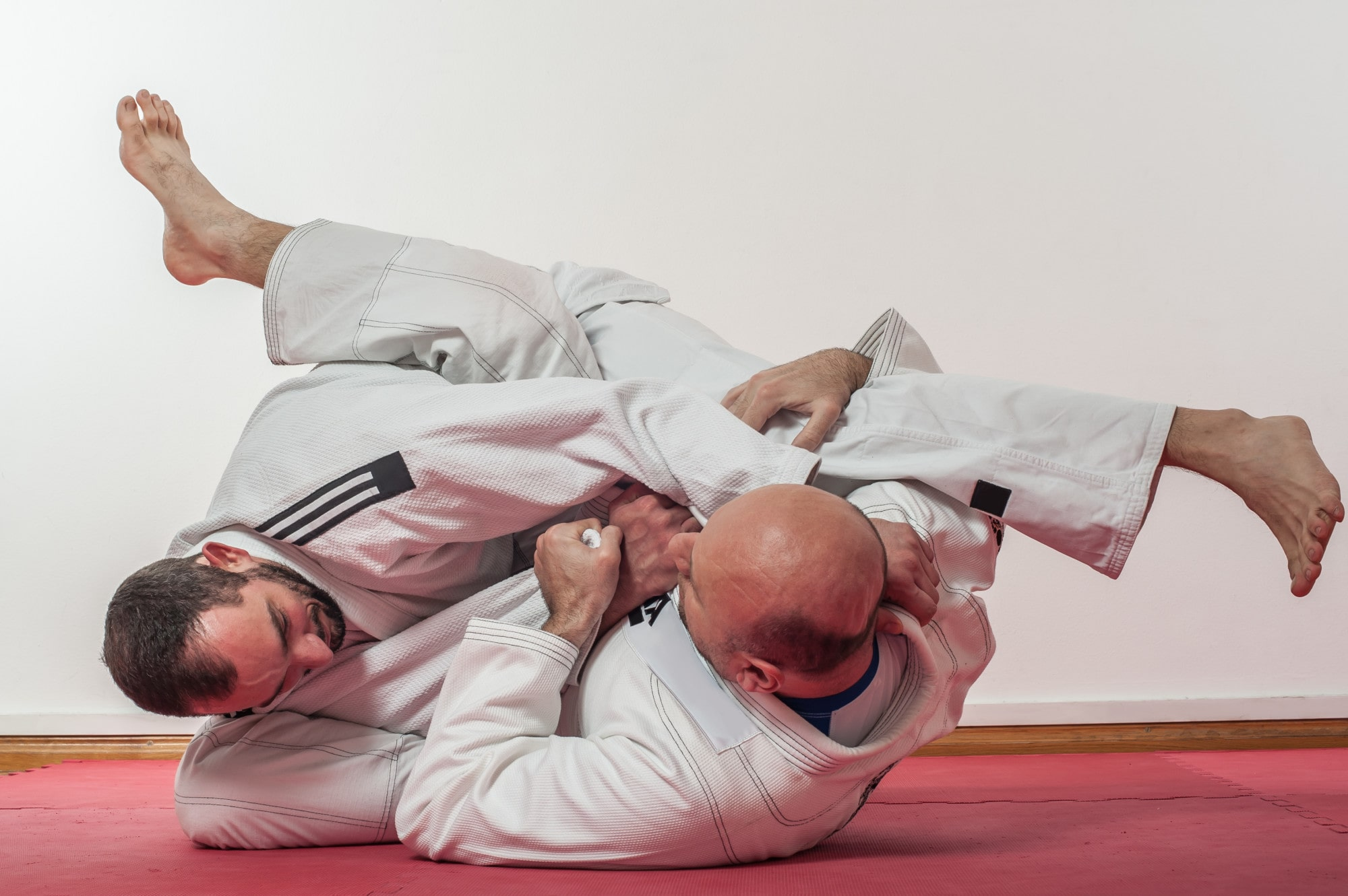bjj practitioner performing a sweep