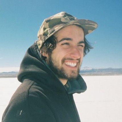 Dylan Glines, the CEO and Founder of Botany Farms stands in the desert. He is a client of Contact Studios.