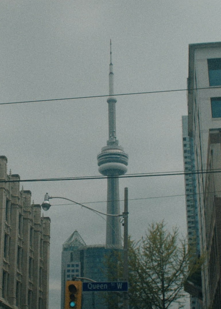 The CN Tower sits behind the morning fog in Toronto. Contact Studios, a creative growth agency is headquartered in Toronto, Canada.