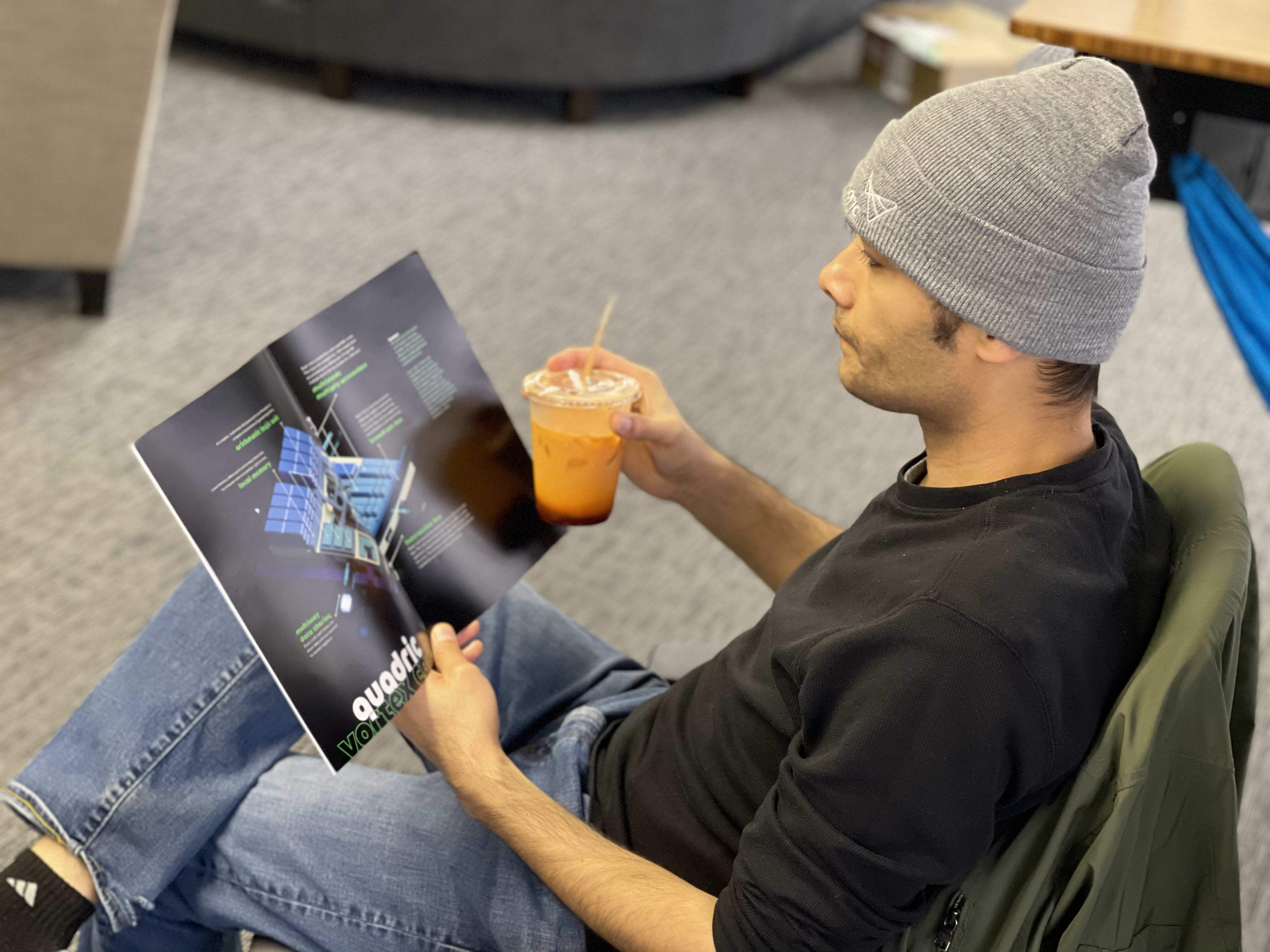 Our CEO, Veerbhan Kheterpal, holding a print magazine featuring quadric's technology.