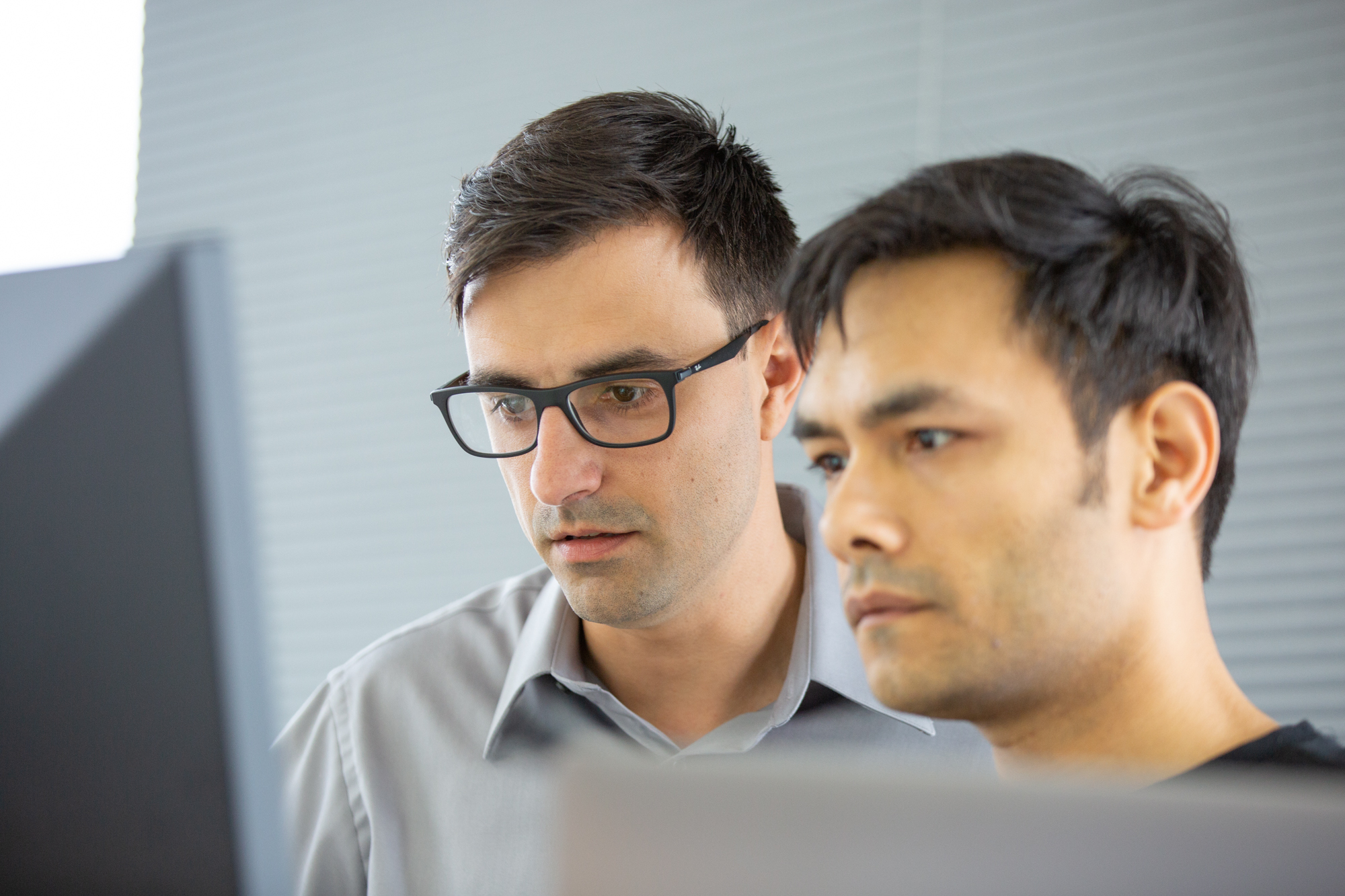 CPO Daniel Firu and CEO Veerbhan Kheterpal reviewing a spreadsheet or something, probably.