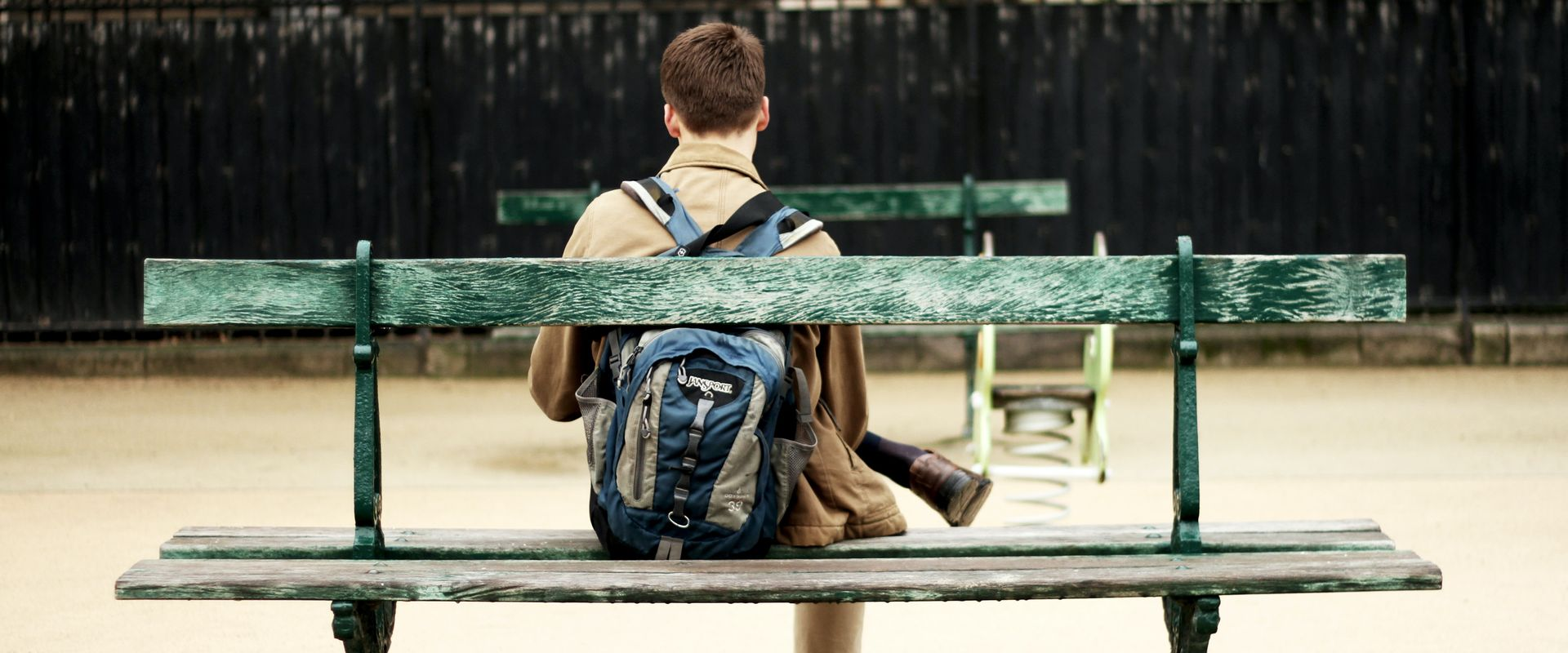 boy on park bench