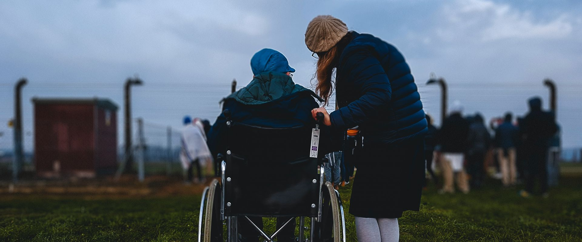 women standing and woman in wheelchair