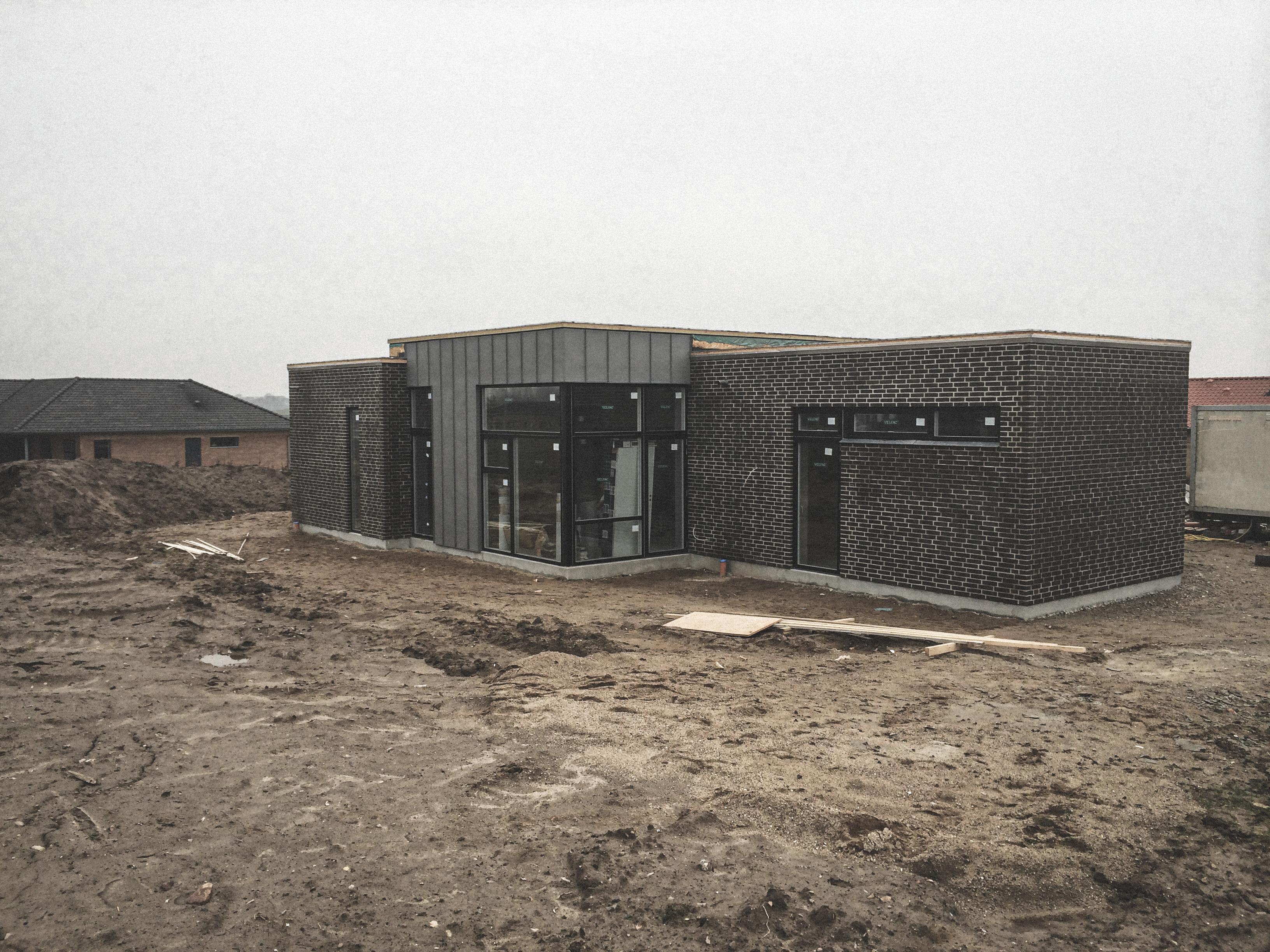 Billede af et igangværende byggeri i Horsens status, tegnet af arkitektfirmaet m2plus.