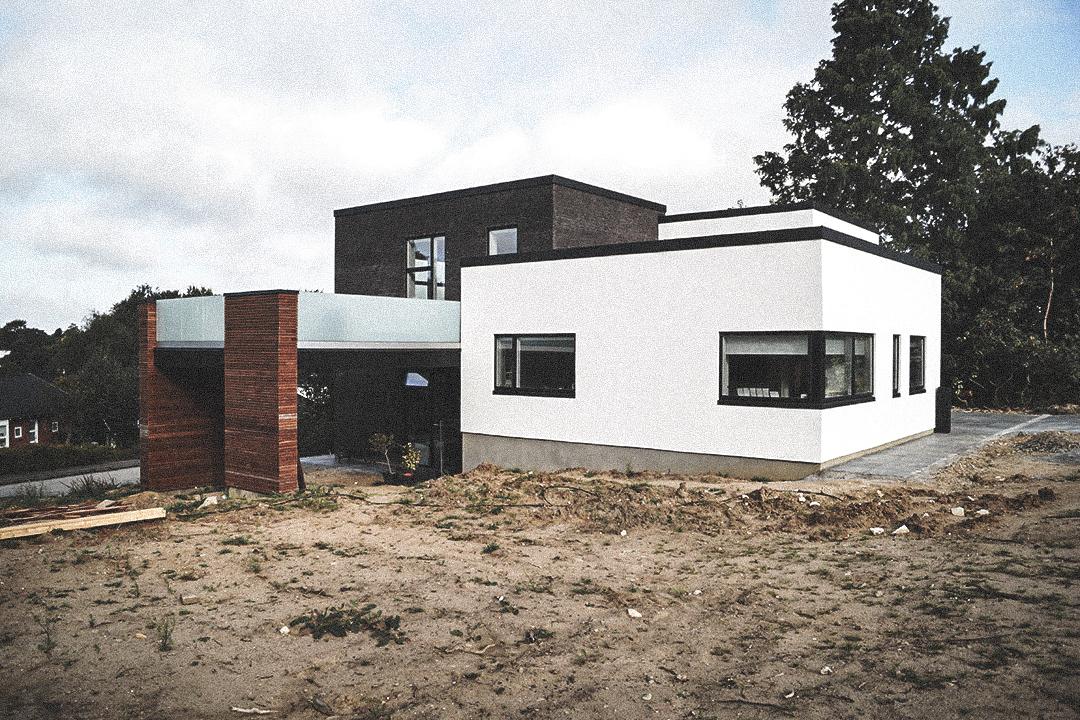 Billede af villa i Højbjerg efter indflytning, tegnet af arkitektfirmaet m2plus.