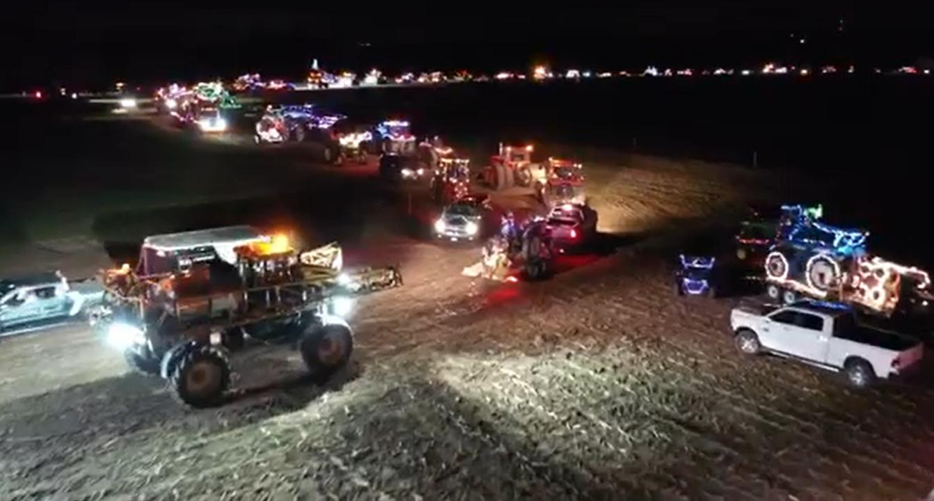 tractor parade at night