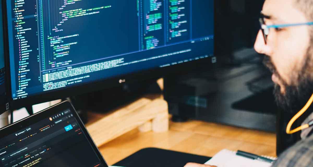 Man working at PC looking at data.