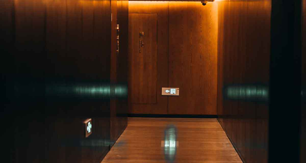 image of an empty hallway with directions