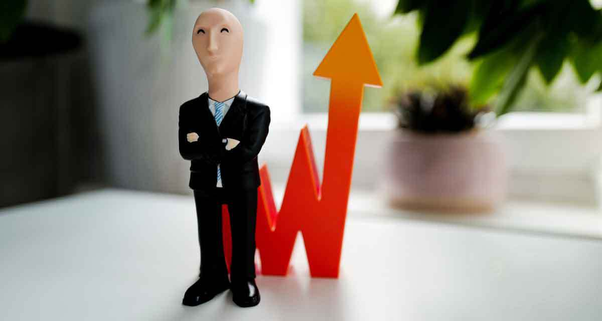 business man statue next to an arrow pointing up