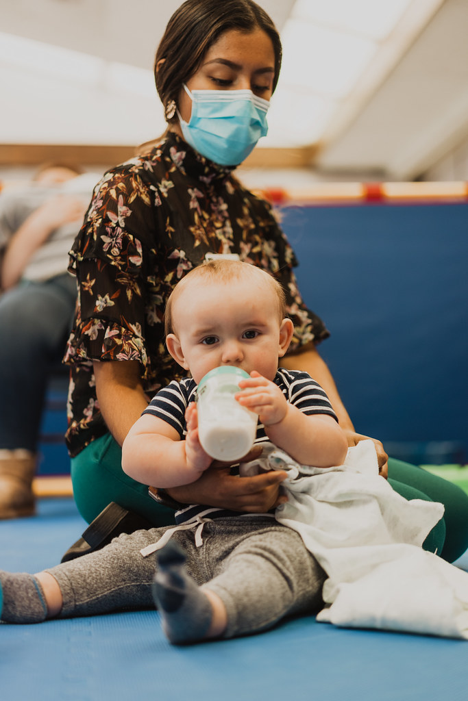 woman taking care of baby at child care services for a non denominational church in Omaha