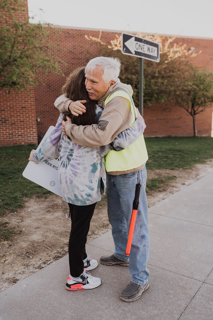 man and woman hugging in parking lot of a christian church in omaha nebraska