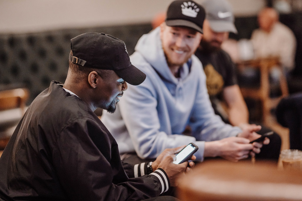 men smiling and reading the bible at a men's small group at a christian church in omaha nebraska