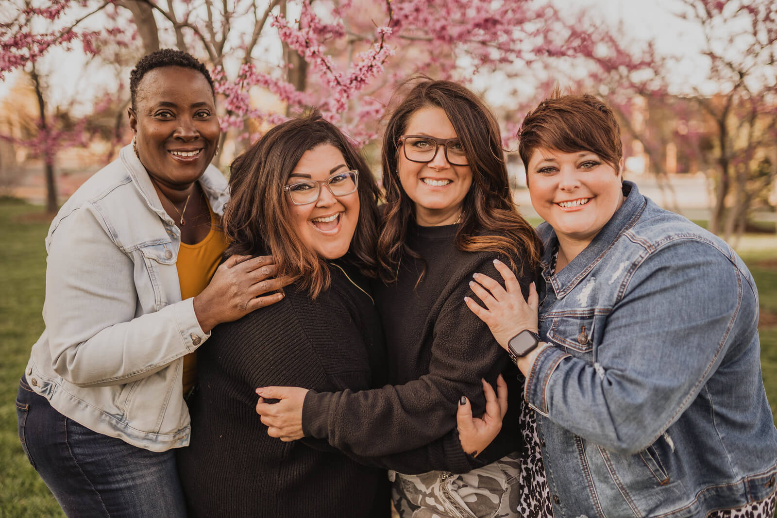 Four women smiling outside at a christian group gather for a church in omaha nebraska