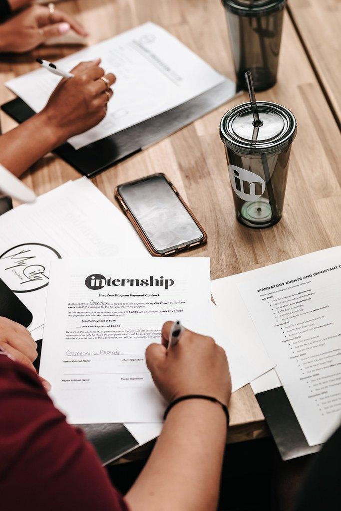 Woman filling out internship homework