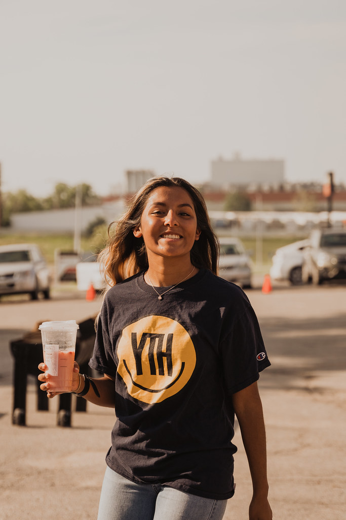 women wearing a youth ministry shirt at a student event in Omaha