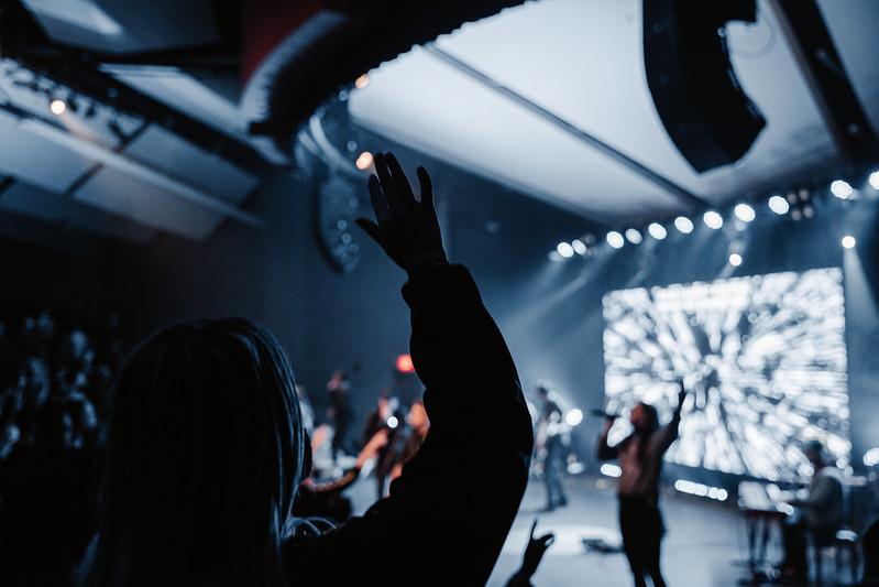 a young Omaha woman worshipping God at a Christian church