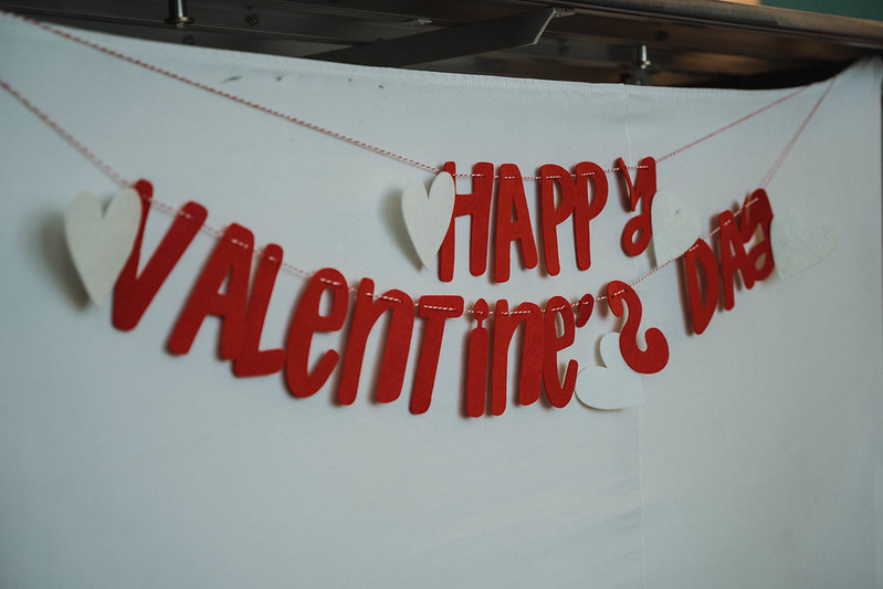 """A paper banner that say's """"Happy Valentines Day"""""""