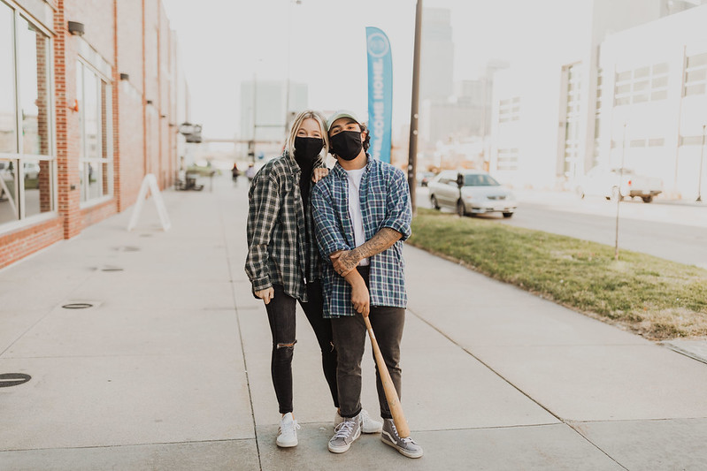 a young couple smiling together in Downtown Omaha