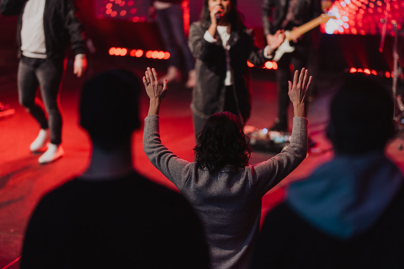 a female pastor worshipping Jesus at an Omaha Christian church