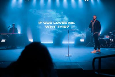 Pastor on stage preaching in omaha nebraska