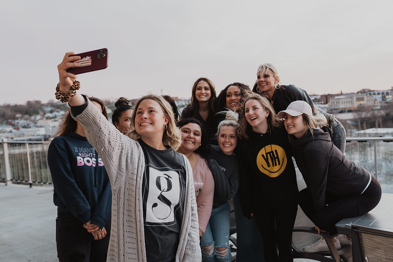 group of girls taking a photo