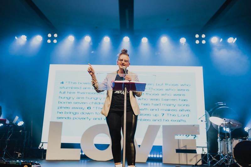 woman preaching on stage in omaha nebraska