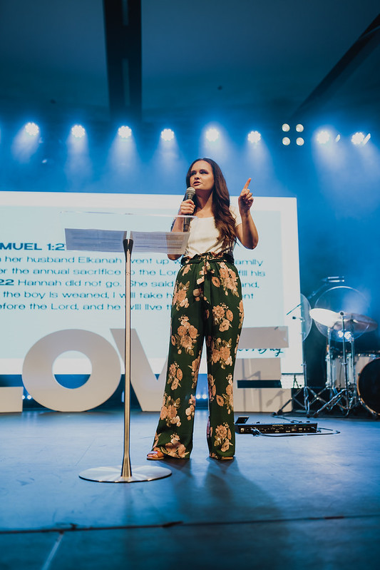 woman preaching on stage in christian church in omaha nebraska