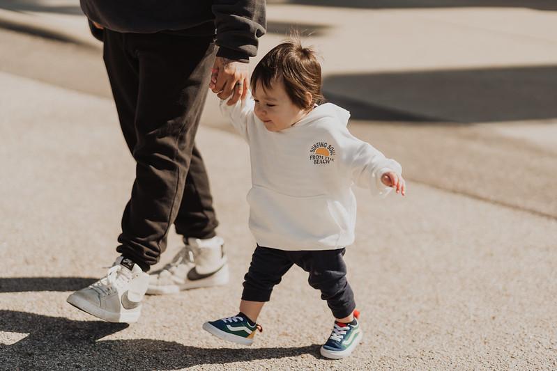 cute baby walking outside of omaha christian church