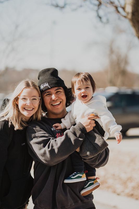 family smiling outside of omaha church in omaha nebraska