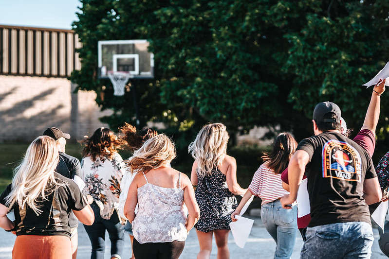christian adults running towards basketball hoop in Omaha nebraska