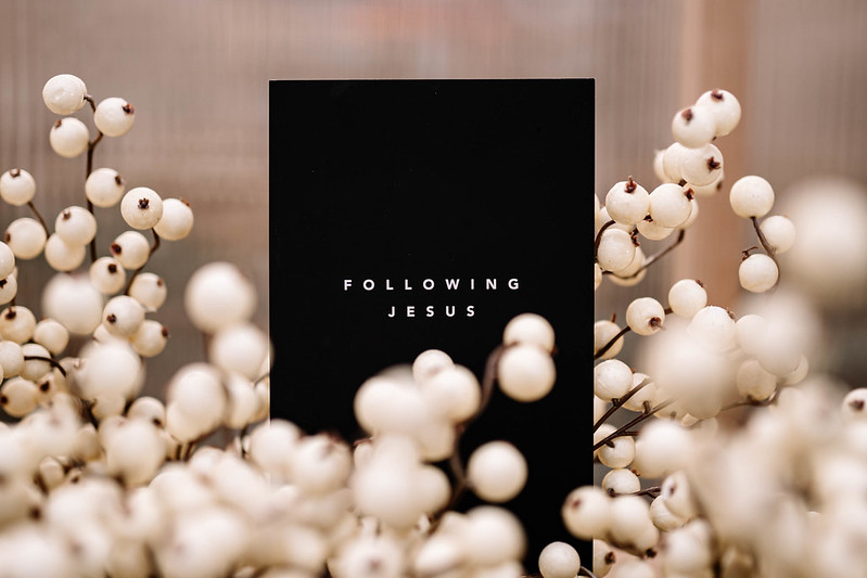 Following jesus book surrounded by white flowers in omaha nebraska
