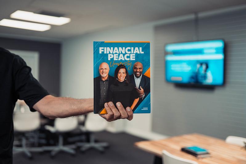 man holding financial peace book in omaha nebraska