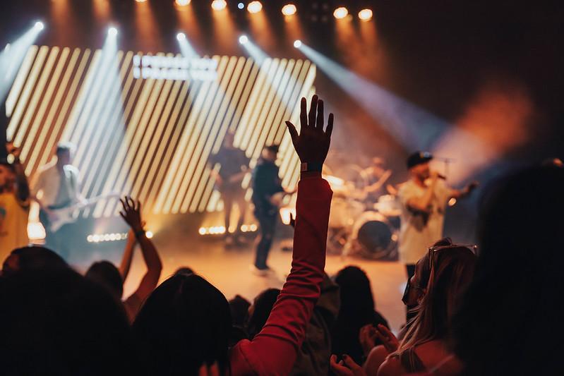 woman raising her hand worshipping at church in omaha nebraska