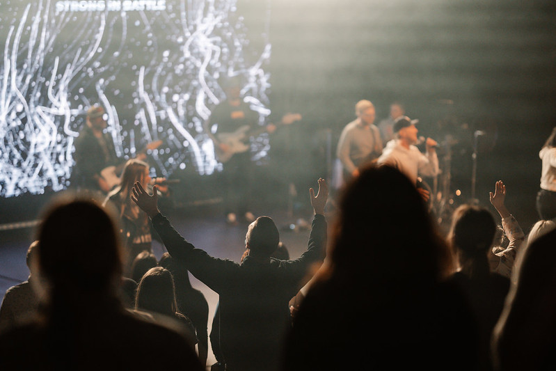 man worshipping with hands in the air at church in omaha nebraska