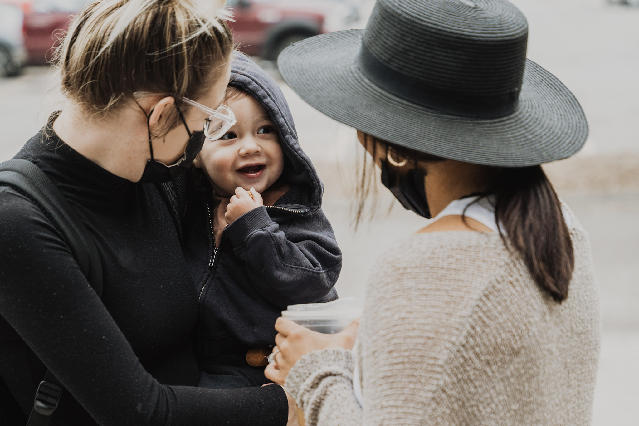 woman holding cute baby outside of church in omaha nebraska