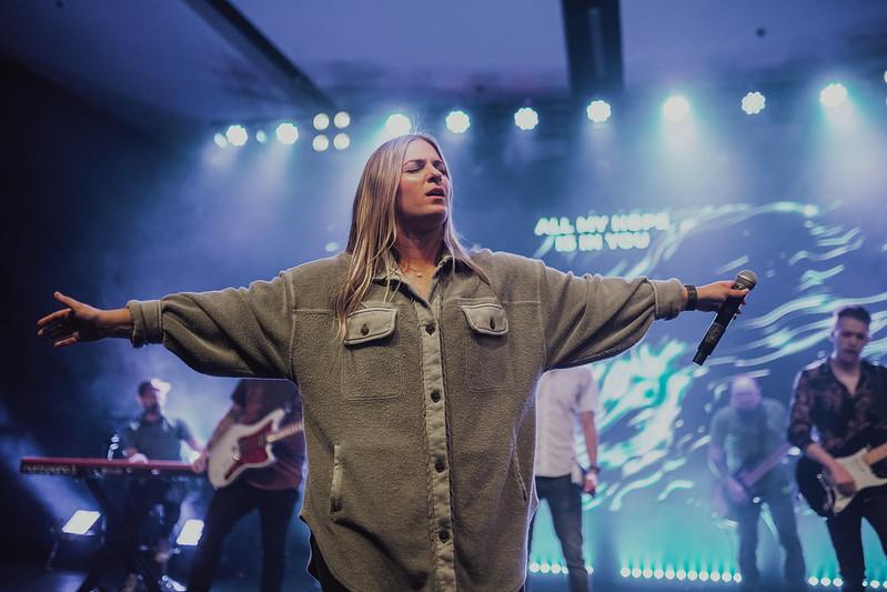 woman on stage worship leading at church in omaha nebraska