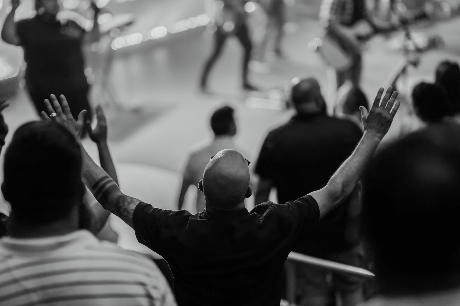 man worshipping in crowd at church in omaha nebraska