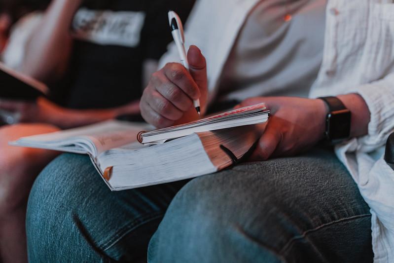 woman journaling during church service in omaha nebraska