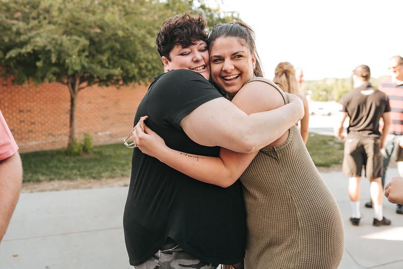 women hugging outside of church in omaha nebraska