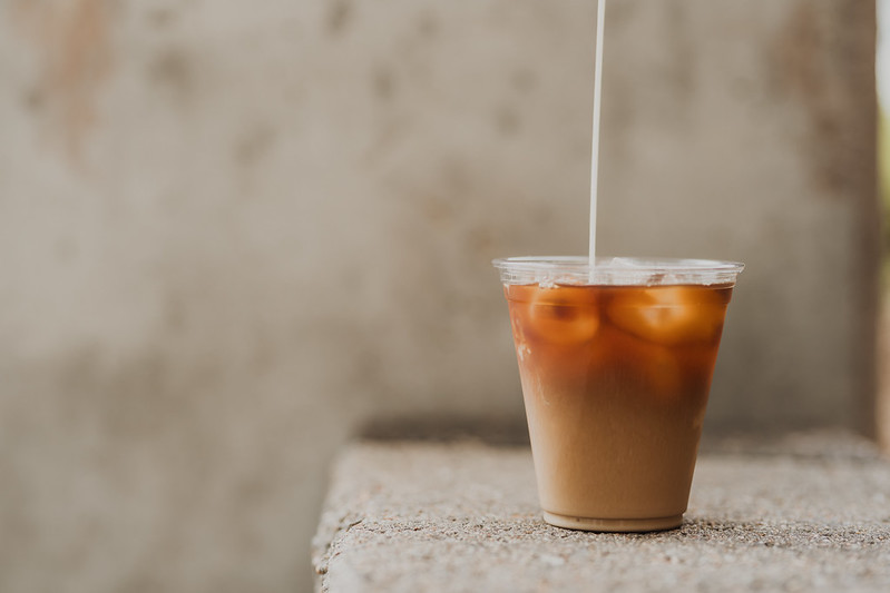creamer being poured into coffee outside of church in omaha nebraska