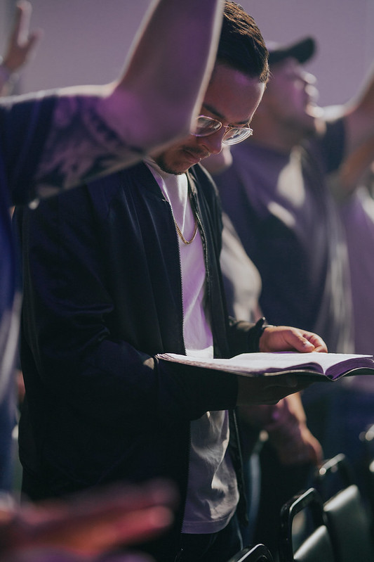 man reading bible during church service at church in omaha nebraska