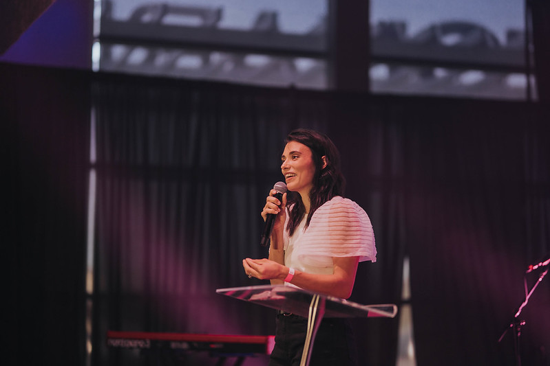 woman lead pastor on stage preaching at church in omaha nebraska