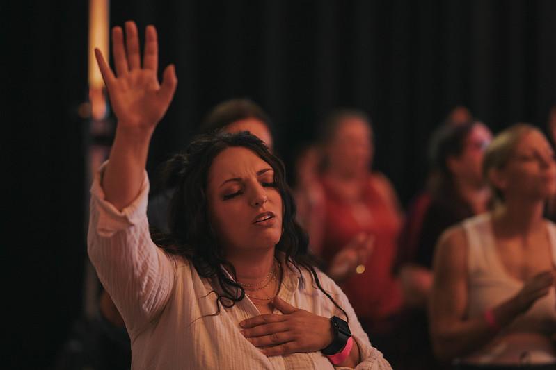 woman worshipping jesus at church in omaha nebraska