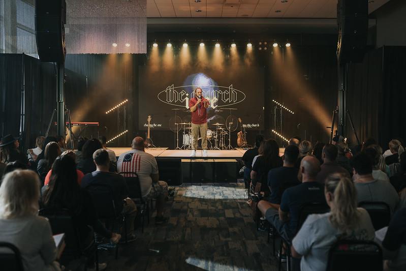 man preaching on stage in christian church in omaha nebraska