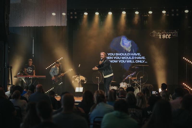 man preaching on stage at church in omaha nebraska