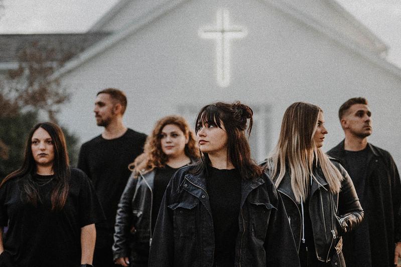 group of christians standing outside of church in omaha nebraska