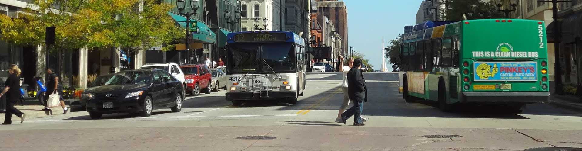 Urban intersection showing buses and pedestrians in Wisconsin