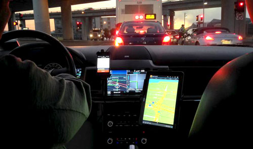 View of roadway from interior of ride-share driver's vehicle