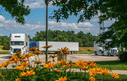 Parking lot at Wisconsin rest stop showing freight-hauling trucks