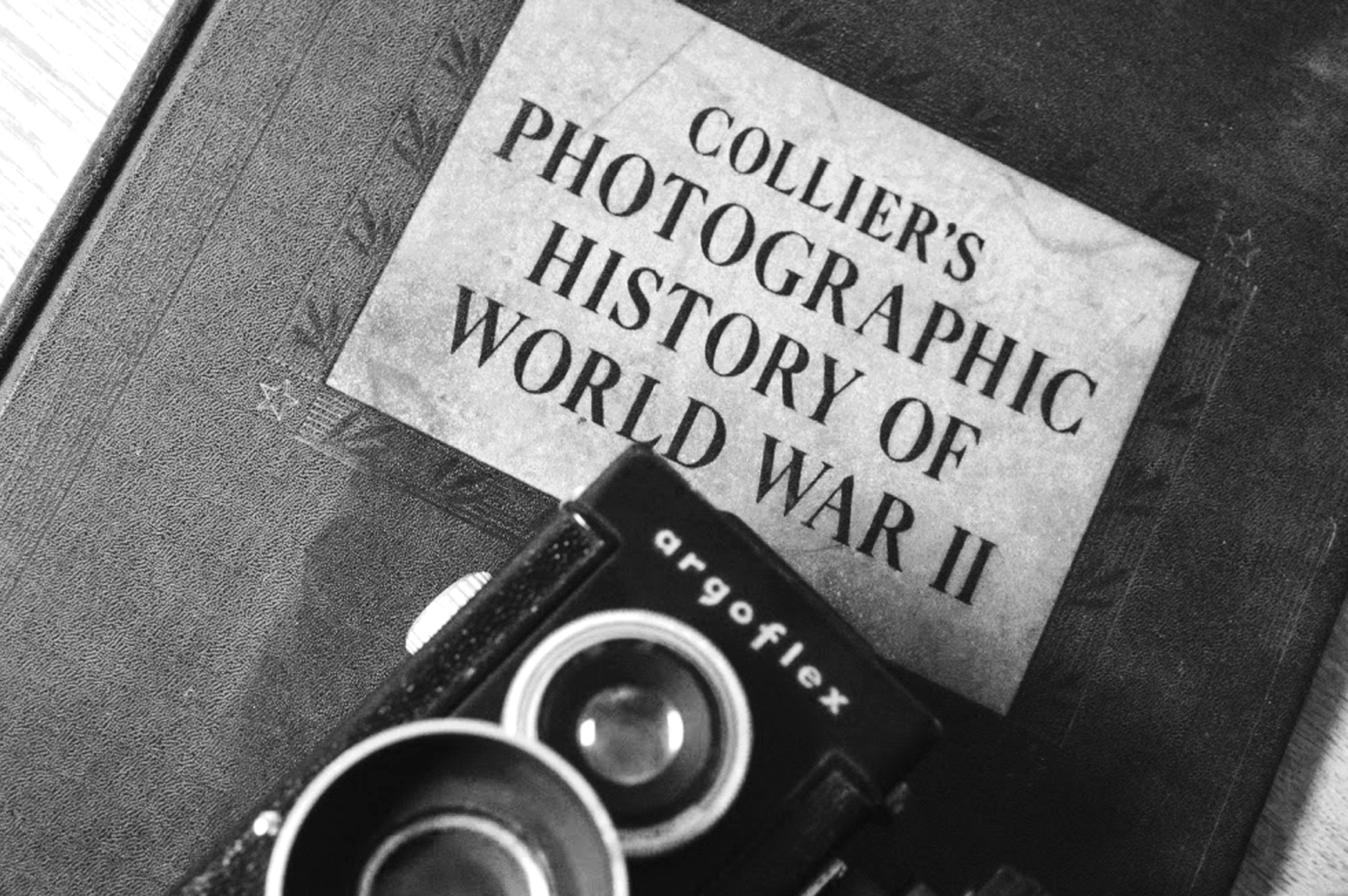 A photo of a camera and history book